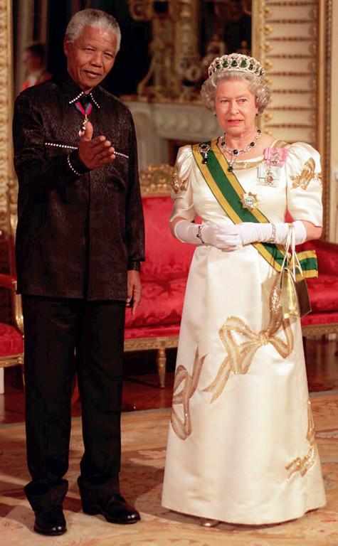 . South African President Nelson Mandela stands with Queen Elizabeth II, on his arrival at Buckingham Palace, for a state banquet in his honour following his arrival in Britain Tuesday July 9, 1996. Mandela is on a four-day state visit to Britain (AP Photo/ WPA ROTA)