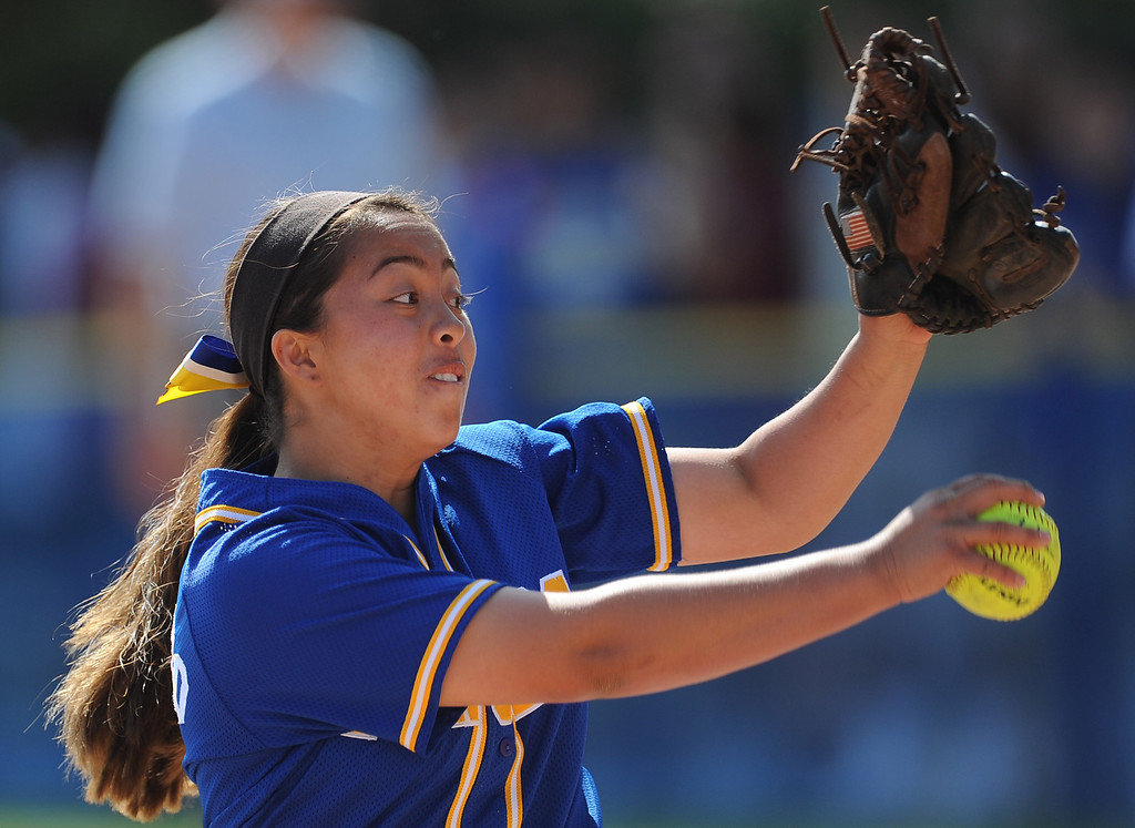 Description of . Bishop Amat starting pitcher Sabrina Anguiano throws to the plate in the first inning of a prep softball game against Santiago at Bishop Amat High School on Wednesday, March 27, 2013 in La Puente, Calif. Bishop Amat won 5-3.  (Keith Birmingham Pasadena Star-News)