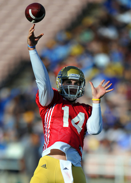 Description of . UCLA quarterback T.J. Millweard (14) during the football spring showcase college football game in the Rose Bowl on Saturday, April 27, 2013 in Pasadena, Calif.    (Keith Birmingham Pasadena Star-News)