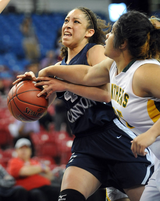 . Sierra Canyon\'s Cheyanne Wallace battles for a rebound with Angelina Mapa of Pinewood High School during the 2013 CIF State Basketball Championships at the Sleep Train Arena, in Sacramento, Ca March 22, 2013.  Sierra Canyon won the game 47-33. (Andy Holzman/Los Angeles Daily News)