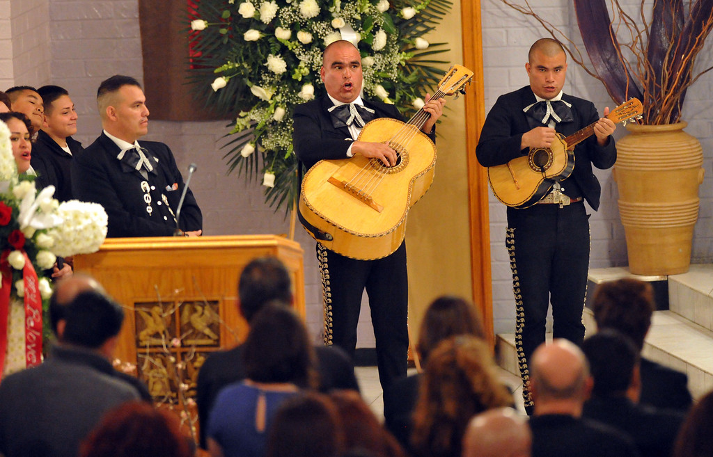 Description of . Mariachis sing as mourners gather to remember restaurant owner Manuel Rojas during the Rosary service at Assumption Church in Boyle Heights on February 25, 2013. Rojas, owner of Manuel's Original El Tepeyac Cafe, he was known for making the famous