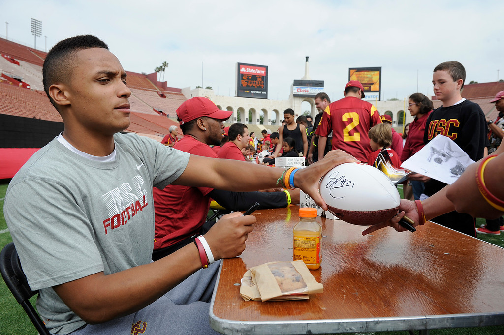 . Safety Su\'a Cravens signs autographs following USC\'s Spring Football Game. (Michael Owen Baker/Staff Photographer)