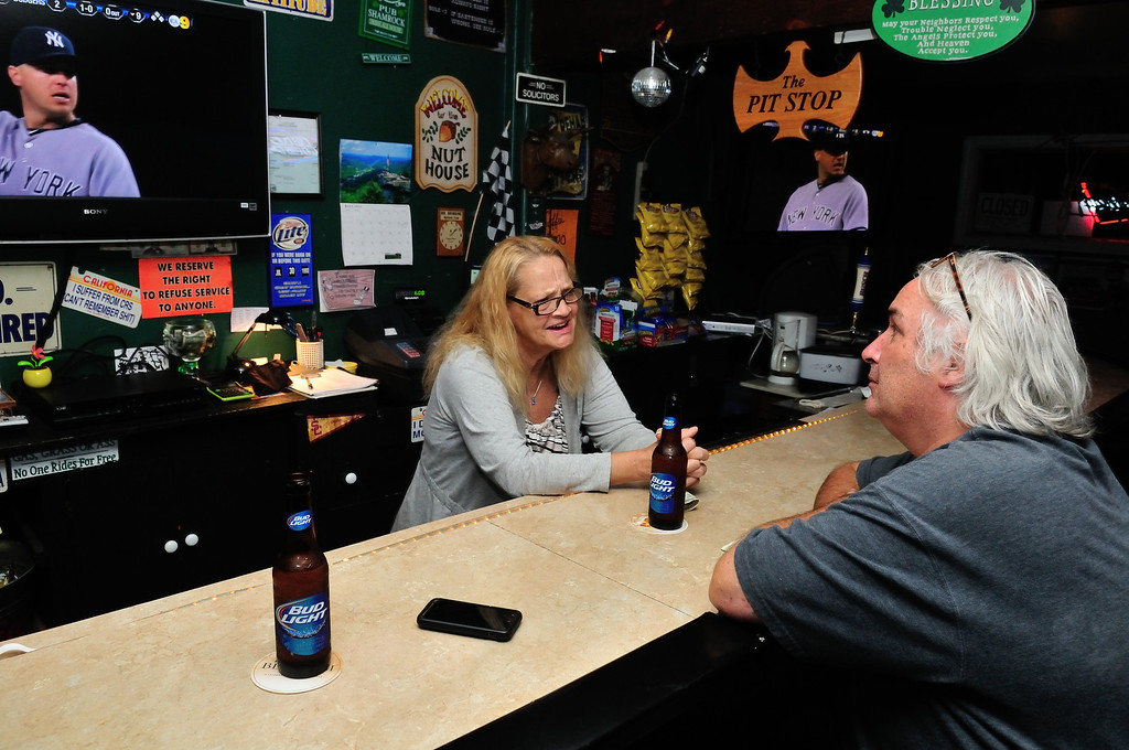 . Tim Grobaty enjoying a beer with bartender, Christine Escobar, at his new neighborhood watering hole, Chuckles and Fern\'s Pit Stop.Photo by Thomas Wasper for the Press Telegram
