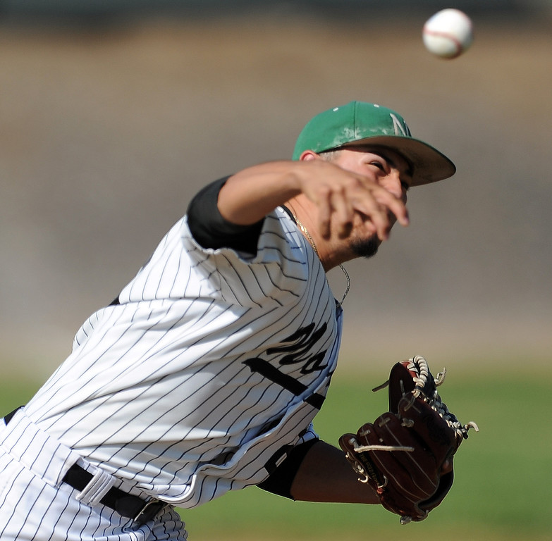 . Nogales starting pitcher Eric Gonzalez throws to the plate against Temple City in the first inning of a prep baseball game at Nogales High School on Tuesday, March 12, 2013 in West Covina, Calif. Nogales won 2-0.  (Keith Birmingham Pasadena Star-News)