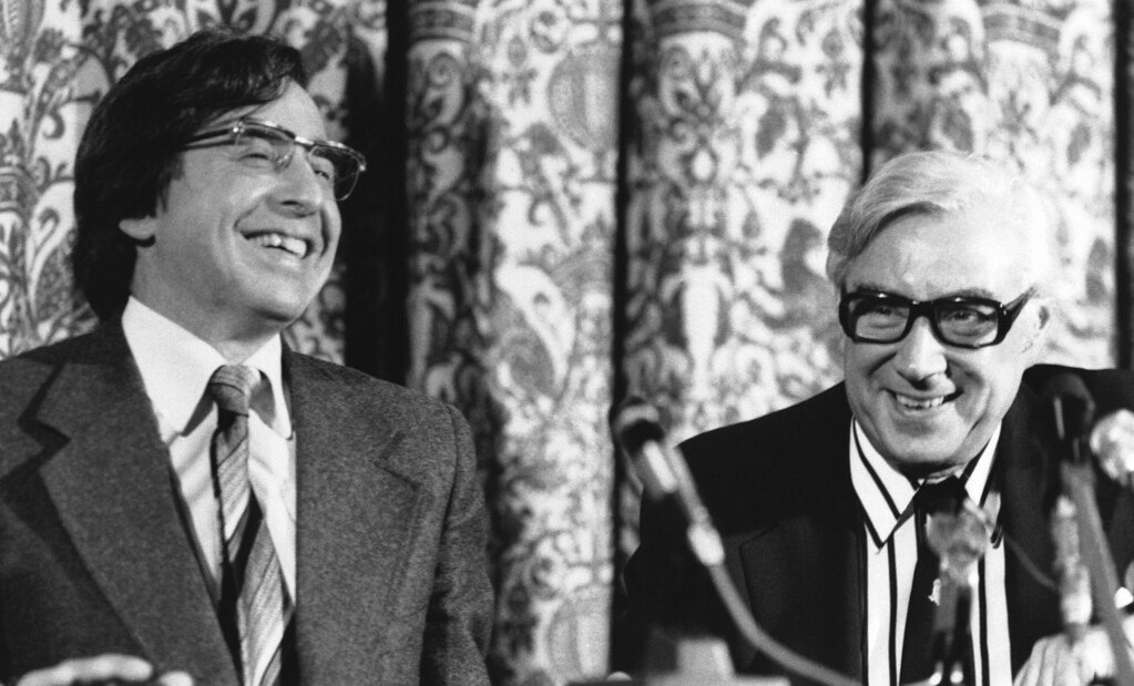 ". Dr. Robert Edwards, left, is all smiles as he sits with gynecologist, Patrick Steptoe, his partner in research for 12 years in ""test tube\""childbirth, July 26, 1978 in Manchester, England. They announced  details of the birth to Bristol housewife, Mrs. Lesley Brown, of a baby girl born in an Oldham Hospital. (AP Photo/Bob Dear)"