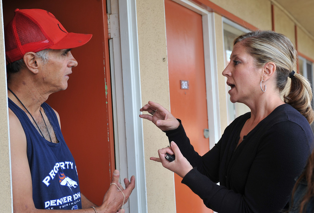 . 080913 - L-R Felipe Rodriguez, talks with Lesley Braden, a registered nurse from Homeless Innovations Project of Mental Health America. Rodriguez has been a client since November 2012 after 7 years of being homeless. Braden administers his medication every 3 days to prevent mis-use or abuse. Photo by Brittany Murray, Press Telegram