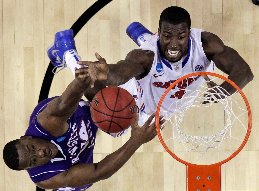 . Florida\'s Patric Young (4) goes up for a shot as Northwestern State\'s Gary Roberson (34) defends during the first half of a second-round game of the NCAA men\'s college basketball tournament Friday, March 22, 2013, in Austin, Texas. (AP Photo/David J. Phillip)