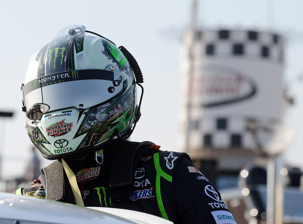 . (Will Lester/Staff Photographer) Kyle Busch exits his race car after qualifying Friday. NASCAR driver Denny Hamlin won the pole position for Sunday\'s Auto Club 400 Friday March 22, 2013. Hamlin lapped the 2-mile super speedway in 38.410 seconds at an average speed of 187.451mph.