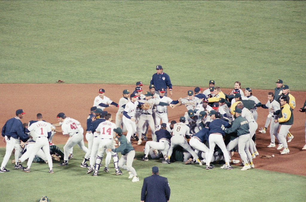 . Oakland Athletics and California Angels brawl on the field after Athletics pitcher Jim Corsi hit Angels Tim Salmon during the seventh inning of the game at Anaheim Stadium, Thursday, May 4, 1995, Anaheim, Calif. The Athletics won 9-6. (AP Photo/Damian Dovarganes)