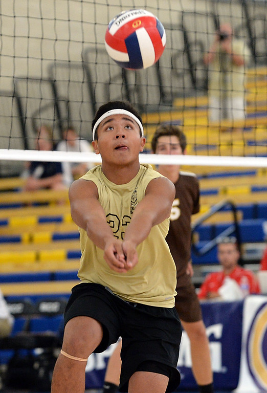 . Bishop Montgomery\'s Justin Arevalo (23) controls, and digs against Parker in a Southern California Regional Division III Final volleyball match Saturday at Santiago Canyon College in Orange. The match came down to the final points of the fifth game, with Bishop Montgomery losing the heart-breaker. Bishop Montgomery vs. Francis Parker (San Diego) 20130525 Photo by Steve McCrank / Staff Photographer