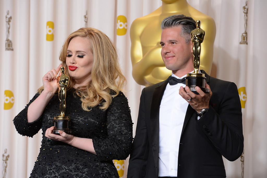 Description of . Singer Adele, left, and musician/producer Paul Epworth won the award for best original song for