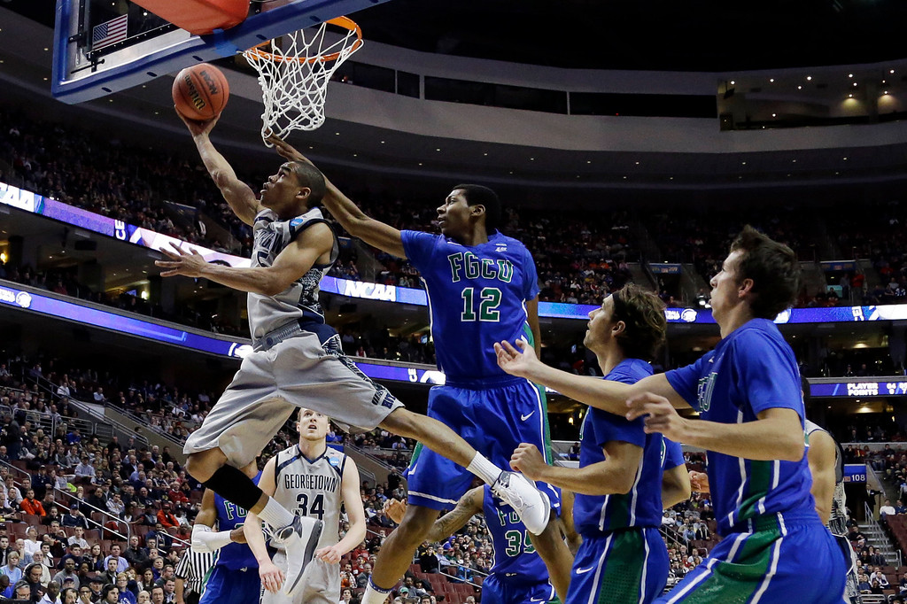 . Georgetown\'s Markel Starks (5) shoots against Florida Gulf Coast\'s Eric McKnight (12) during the first half of a second-round game of the NCAA college basketball tournament on Friday, March 22, 2013, in Philadelphia. (AP Photo/Matt Rourke)