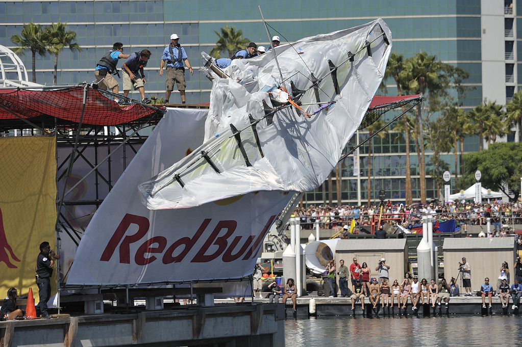 ". LONG BEACH, CALIF. USA -- Flugtag team members throw their entry ""Flies Like a Butterfly, but Stings Like a Ray\""after it failed to roll down the ramp in Rainbow Harbor in Long Beach, Calif. on August 21, 2010. Thirty five teams competed in the Red Bull event where teams build homemade, human-powered flying machines and pilot them off a 30-foot high deck in hopes of achieving flight.  Flugtag means \""flying day\"" in German. They are on distance, creativity and showmanship..Photo by Jeff Gritchen / Long Beach Press-Telegram.."