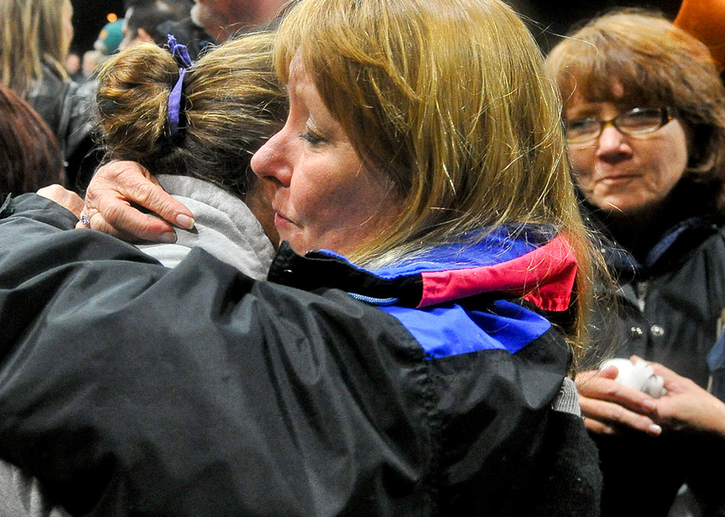 Description of . Dawn MacKay, mother of fallen San Bernardino County Sheriff's Detective Jeremiah MacKay, receives condolences from friends at the conclusion of a candlelight vigil in honor of her son at Yucaipa Community Center in Yucaipa, Calif. on Tuesday, Feb. 19, 2013. MacKay was killed by fugitive ex-cop Christopher Dorner on Feb. 12 during a fiery shootout in which Dorner barricaded himself in a cabin near Big Bear. (Rachel Luna / Staff Photographer)