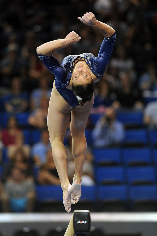 . UCLA\'s Kaelie Baer performs on the balance beam at the NCAA Women\'s Gymnastics Championship Team Finals at Pauley Pavilion, Saturday, April 20, 2013. (Michael Owen Baker/Staff Photographer)