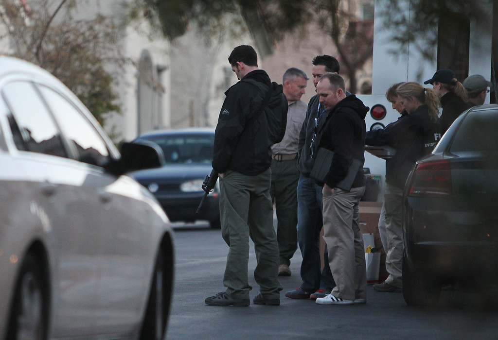 Description of . FBI agents gather in front of the Las Vegas home owned by Christopher Jordan Dorner on Thursday, Feb. 7, 2013. Two Riverside police officers were shot early Thursday morning, one fatally, with the second in critical condition, both were believed to have been shot in a ambush by ex LAPD officer Christopher Jordan Dorner who is still at large. Dorner is also the suspect in the murder of an Irvine couple on Sunday.  (Jason Bean/Las Vegas Review-Journal)