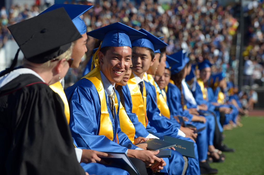 . William Leung enjoys a moment with fellow seniors.  He is headed to Berkeley. The 2013 North High School commencement ceremonies take place on the school\'s football field in Torrance Wednesday afternoon.