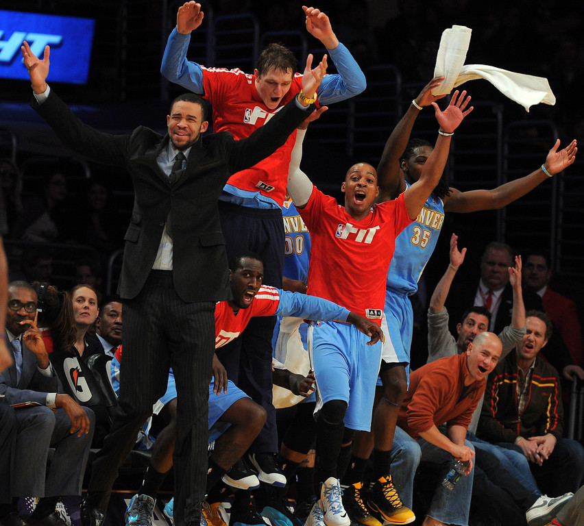 . The Denver Nuggets bench erupts after a Nate Robinson dunk at the Staple Center in Los Angeles, CA on Sunday, January 5, 2014. 2nd half. Denver Nuggets beat the Lakers 137-115.  (Photo by Scott Varley, Daily Breeze)