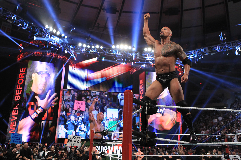 ". In this image released by WWE, actor and wrestler Dwayne ""The Rock\"" Johnson competes in the 25th Anniversary of Survivor Series at Madison Square Garden, Sunday, Nov. 20, 2011 in New York. Returning to the wrestling ring after seven years, The Rock teamed with WWE Superstar John Cena in the main event against the Tag team of \""Awesome Truth,\"" consisting of wrestlers The Miz and R-Truth. (AP Photo/WWE)"