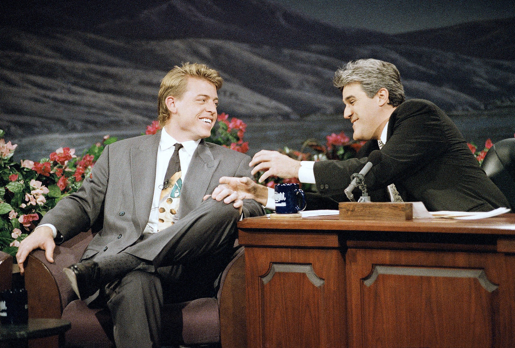 ". Dallas Cowboys\' quarterback Troy Aikman, left, the Most Valuable Player of Super Bowl XXVII, shares a laugh with ""The Tonight Show\"" host Jay Leno during the taping of the show in Burbank, Calif., Feb. 1, 1993. (AP Photo/Kevork Djansezian)"