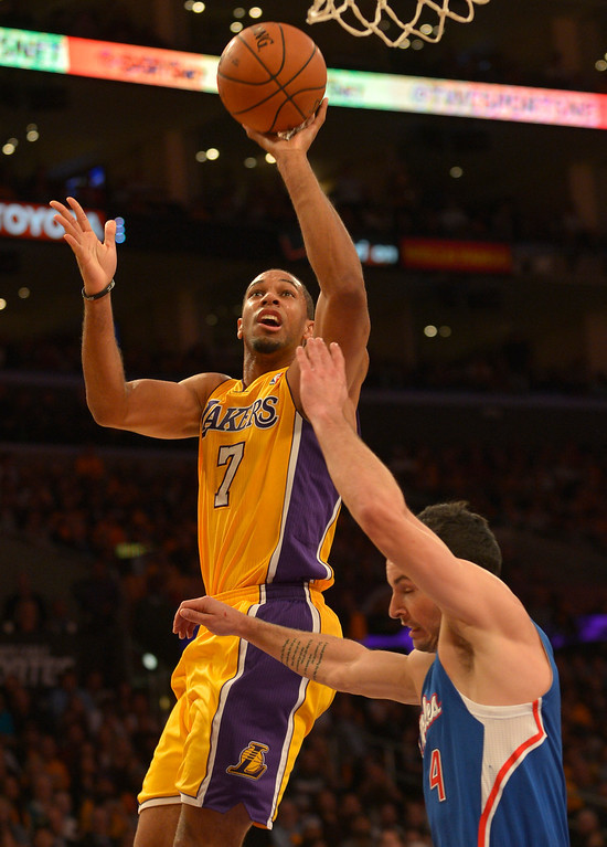 . Lakers#7 Xavier Henry shoots over Clippers#4 J.J. Redick in the 4th quarter The Los Angeles Lakers defeated the Clippers 116 to 103 in the opening game of the season at Staples Center. Los Angeles, CA. 10/29/2013. photo by (John McCoy/Los Angeles Daily News)