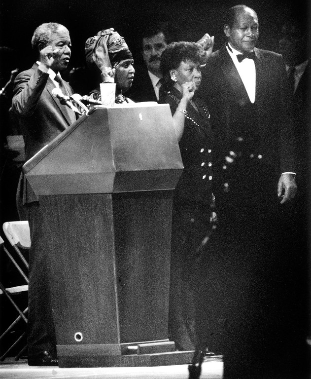 . June 1990: Nelson Mandela, Winnie Mandela, Maxine Waters and Mayor Tom Bradley gesture to crowd at conclusion of a rally at the L.A. Coliseum.  Daily News file photo