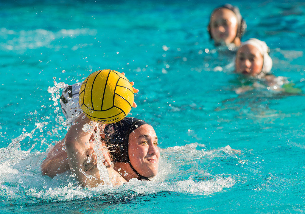 Description of . La Serna High's Gabby Pierandozzi is fouled while taking a goal shot vs Temple City High in the CIF-SS girls water polo first-round game at Whittier High Feb. 14, 2013.   (SGVN/Staff photo by Leo Jarzomb)
