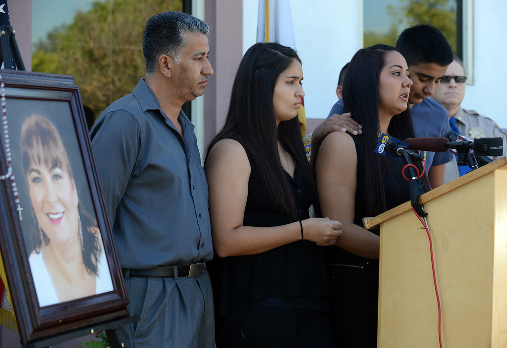 . The victim\'s family members, Salvador Rivera Sr., left, daughters Alondra and Maribel and son Salvador Jr., ask for the public\'s help during a press conference with the CHP at the Rancho Cucamonga station Tuesday, October 1, 2013. The department is seeking information about a hit and run in Fontana that killed Maria De Los Angeles Chagolla in August. (Jennifer Cappuccio Maher/Inland Valley Daily Bulletin)