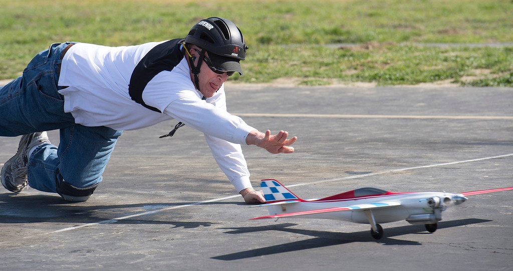 . Chuck Andraka of Albuquerque launches his plane for a practice run.  The San Gabriel Valley Radio Control League members fly their planes at Whittier Narrows Recreation Area Feb. 21, 2013 practicing for the upcoming Basin Q40 Classic pylon racing event at Apollo Field in the Sepulveda Basin this weekend.  (SGVN/Staff photo by Leo Jarzomb)