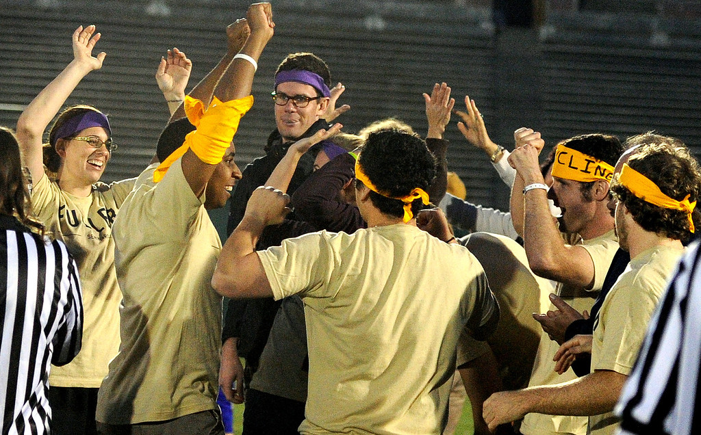 Description of . Fuller Seminary reacts after wining the puzzle building competition during the the 2013 Collegiate Field Tournament at the Rose Bowl on Friday, April 5, 2013 in Pasadena, Calif.  (Keith Birmingham Pasadena Star-News)