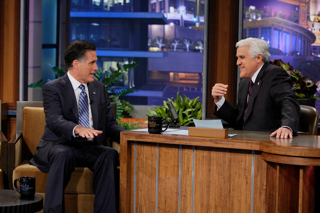 . In this photo provided by NBC, Republican presidential candidate, former Massachusetts Gov. Mitt Romney talks with Jay Leno during his appearance on The Tonight Show in Burbank, Calif., Tuesday, March 27, 2012. Romney cracked Tuesday night that he\'d pick Leno rival David Letterman as his vice president, talked at length about health policy and said he\'d be happy to have a rival of his own, Rick Santorum, serve in a Romney administration. (AP Photo/NBC, Paul Drinkwater)