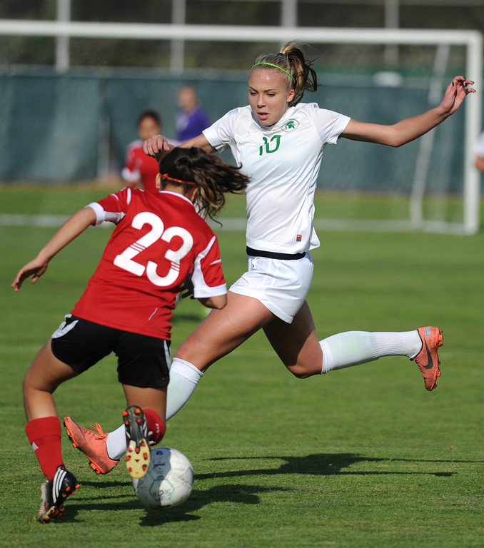 . 02-21-2012--(LANG Staff Photo by Sean Hiller)- South Torrance girls soccer beat Artesia 5-0 in Thursday\'s CIF Southern Section Division IV quarterfinal at South High. Kyla Diekmann (10) over powers Artesia\'s Diana Mota (23).