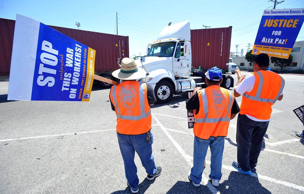 . Every few minutes, picketers break their line to allow trucks to enter and exit the Evergreen terminal on Terminal Island, CA on Wednesday, July 9, 2014. Truckers are in their third day of their port strike.  (Photo by Scott Varley, Daily Breeze)