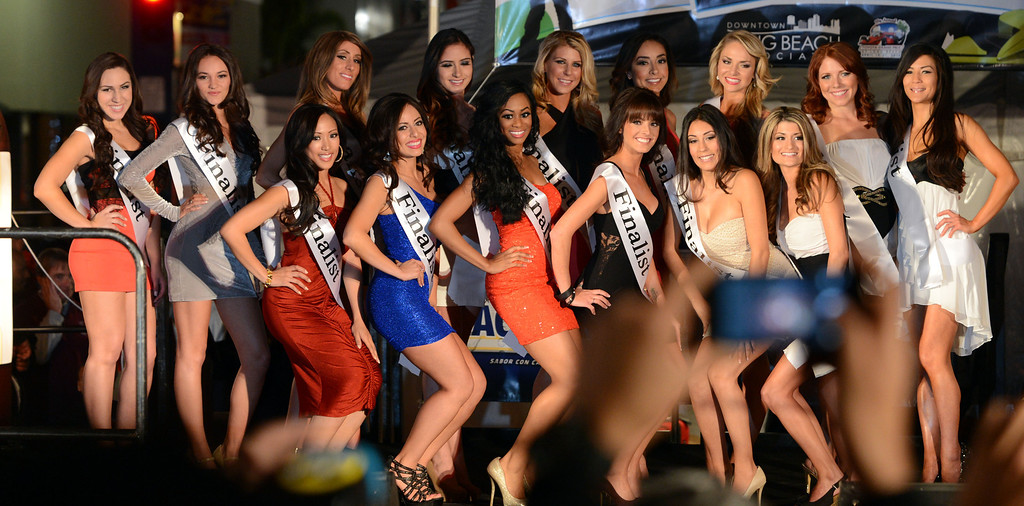 . Long Beach, Calif., -- 04-18-13-  Finalsts in the 2013 Tecate Light Miss Toyota Grand Prix of Long Beach  pageant Thursday night on Pine Avenue at the Tecate Light Thunder Thursday on Pine.   Stephen Carr/  Los Angeles Newspaper Group
