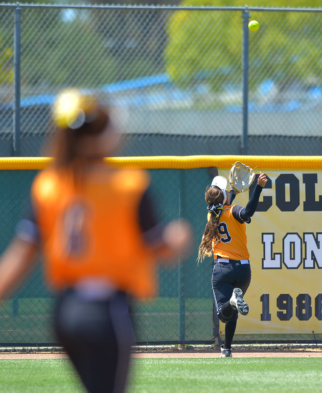 . LBSU right fielder Sarah Carrasco is unable to catch a fly ball at the fence on an RBI triple hit by Cal Poly\'s Courtney Tyler as LBSU lost to Cal Poly softball 3-0 in Long Beach, CA on Sunday, May 4, 2014.  (Photo by Scott Varley, Daily Breeze)