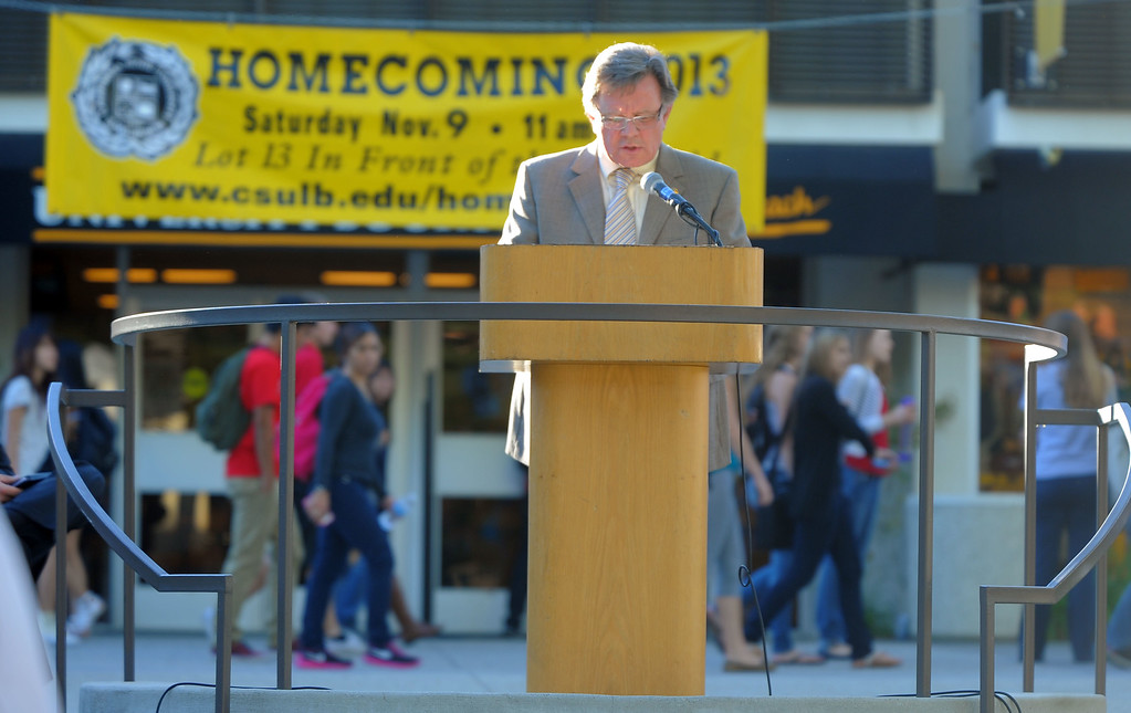 . CSULB celebrates Veterans Day with a short ceremony on the upper campus in Long Beach, CA on Thursday, November 7, 2013.  Between classes, students pass behind interim CSULB President Donald Para as he delivers his remarks. (Photo by Scott Varley, Daily Breeze)