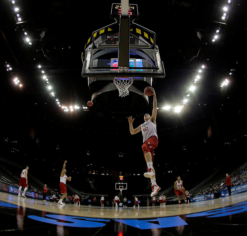 . Wisconsin forward/center Jared Berggren (40) shoots during practice for a second-round game of the NCAA college basketball tournament Thursday, March 21, 2013, in Kansas City, Mo. Wisconsin is scheduled to play Mississippi Friday. (AP Photo/Charlie Riedel)