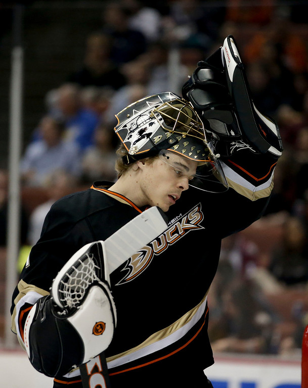 . Anaheim Ducks goalie Jonas Hiller, Switzerland, wears his mast during the first period of an NHL hockey game against the Colorado Avalanche in Anaheim, Calif., Wednesday, April 10, 2013. (AP Photo/Jae C. Hong)