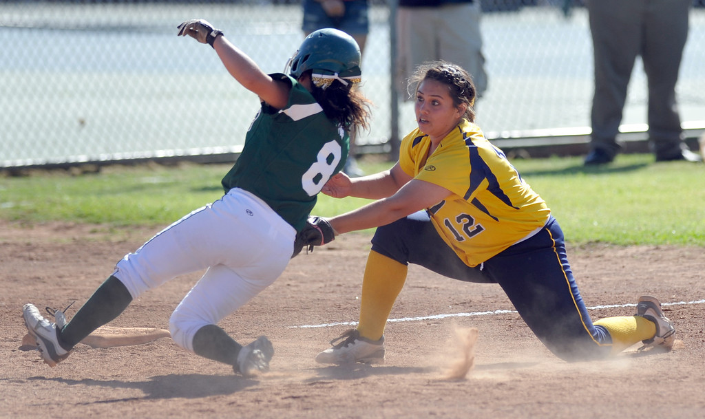 . Montebello pitcher Evelyn Hernandez (#12) tags out   Schurr\'s Breanna Bolanos (#8) at third base in their Almont League girls softball game at Montebello High School on Thursday April 18, 2013. Montebello beat Schurr 10-8. (SGVN/Staff Photo by Keith Durflinger)