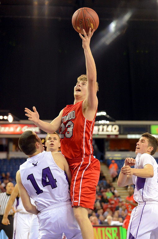 . Redondo Union High School\'s Derek Biale puts up a shot against College Park High School during the Division II 2013 CIF State Basketball Championships at Sleep Train Arena, in Sacramento, Ca March 23, 2013.  Redondo won the game 54-47.(Andy Holzman/Los Angeles Daily News)