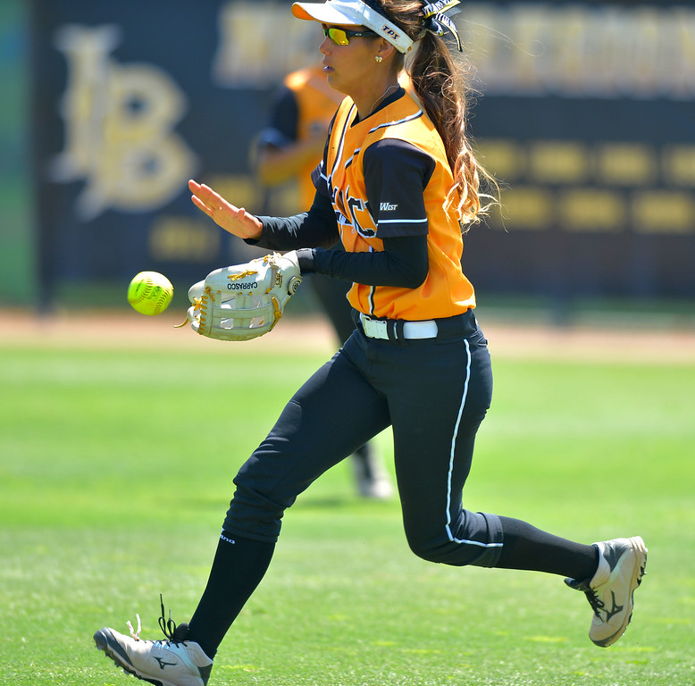 . LBSU right fielder Sarah Carrasco fields a ball on a bounce as LBSU lost to Cal Poly softball 3-0 in Long Beach, CA on Sunday, May 4, 2014.  (Photo by Scott Varley, Daily Breeze)