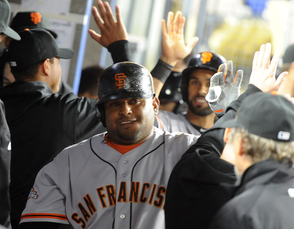 . San Francisco Giants\' Pablo Sandoval smiles after hitting a two run home run in the third inning of their baseball game against the Los Angeles Dodgers on Wednesday, April 3, 2013 in Los Angeles. 