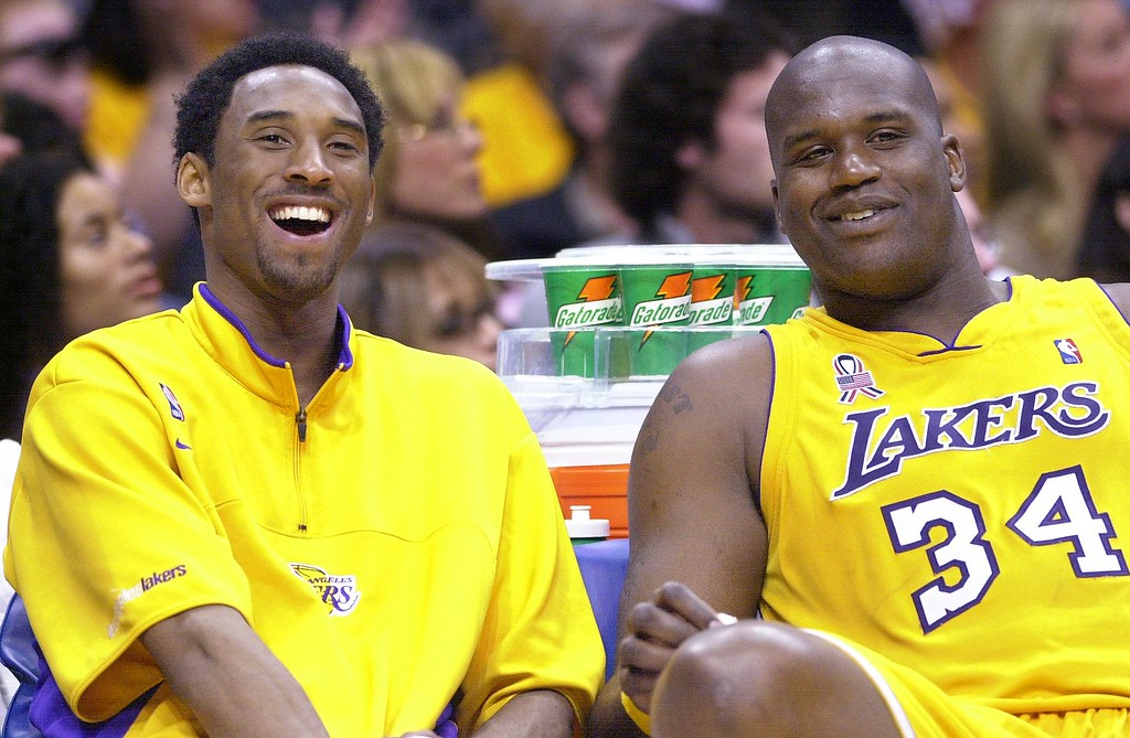 . Los Angeles Lakers\' Kobe Bryant, left, and teammate Shaquille O\'Neal laugh as they watch the end of their game against the Sacramento Kings from the bench, Wednesday night, April 17, 2002, in Los Angeles. The Lakers won 109-95. Let\'s sum up the NBA playoffs with a five-word question: Can anybody beat the Lakers?  (AP Photo/Mark J. Terrill)