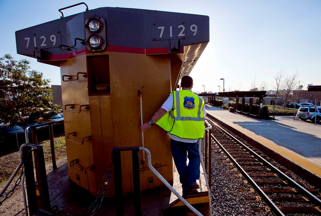 Description of . Conductor Russ Avery walks along a Union Pacific freight train during a railroad safety education event in City of Industry on Friday, Feb. 22, 2013. (SGVN/Staff photo by Watchara Phomicinda)