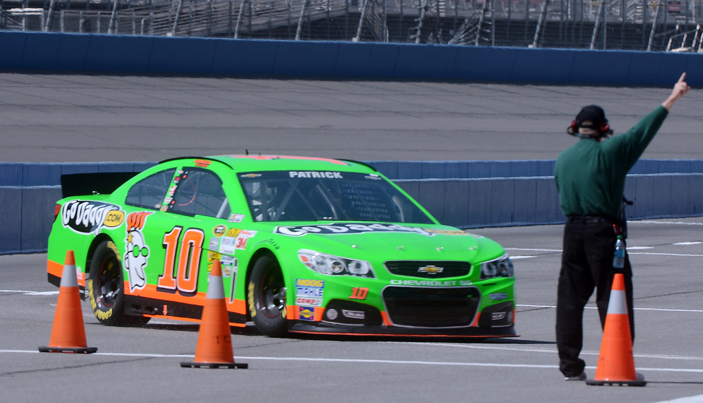 . (Will Lester/Staff Photographer) NASCAR driver Danica Patrick pulls off the race track during the opening practice session for Sunday\'s Auto Club 400 Friday March 22, 2013.