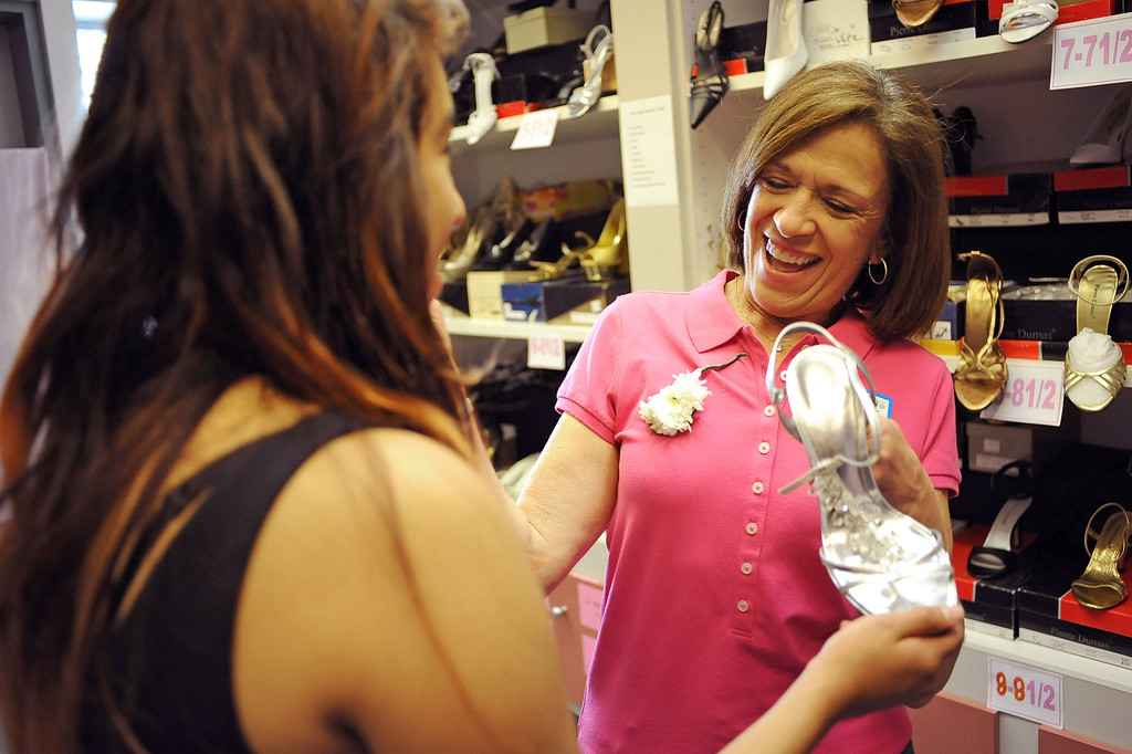 . Linda Levine is all smiles while helping a student select shoes during Operation School Bell\'s annual Prom Day event at the Assistance League of Los Angeles Thursday March 7, 2013.  Fifty-five homeless or needy LAUSD high school girls were able to select a dress, shoes and accessories during the event.(Andy Holzman/Los Angeles Daily News)