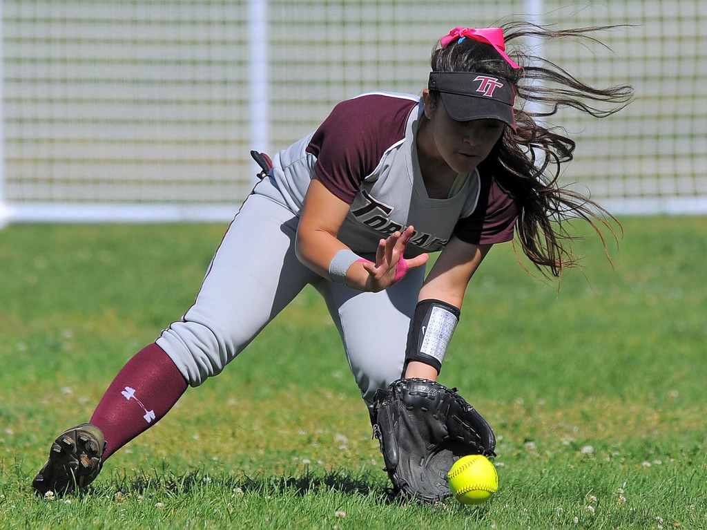 . TORRANCE - 04/03/2013  (Photo: Scott Varley, Los Angeles Newspaper Group)  South vs Torrance softball in a Pioneer League matchup. Torrance\'s Mo Ramirez fields a ball in center field.