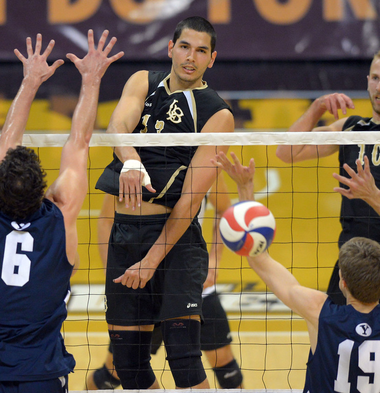 . Taylor Gregory hits for LBSU in Long Beach, CA on Friday, March 7, 2014 #2 BYU vs #3 Long Beach State men\'s volleyball at Walter Pyramid. (Photo by Scott Varley, Daily Breeze)