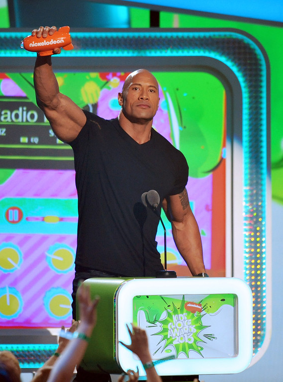 . Dwayne Johnson accepts the award for favorite male buttkicker at the 26th annual Nickelodeon\'s Kids\' Choice Awards on Saturday, March 23, 2013, in Los Angeles. (Photo by John Shearer/Invision/AP)