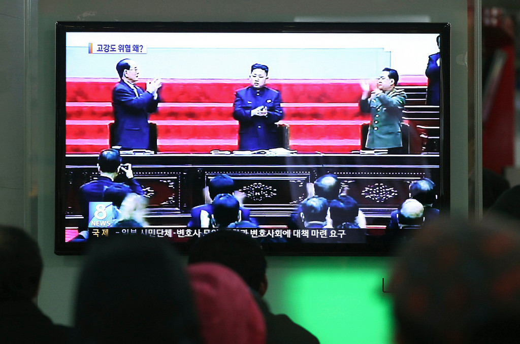 ". People watch a TV news report showing North Korean leader Kim Jong Un, center, and other leaders, at Seoul Railway Station in Seoul, South Korea, Saturday, March 30, 2013. North Korea warned Seoul on Saturday that the Korean Peninsula was entering ""a state of war\"" and threatened to shut down a factory complex that\'s the last major symbol of inter-Korean cooperation.(AP Photo/Ahn Young-joon)"